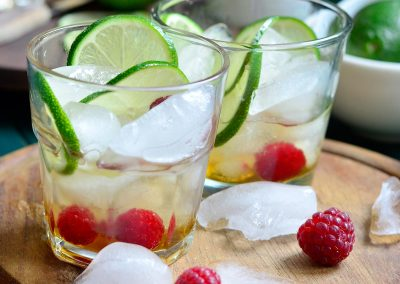 Infused Maple and Rum Cocktail with Lime and Raspberries